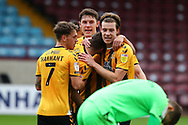 GOAL Cambridge United  2 Scunthorpe United 0 players celebrate after Paul Mullin second succesfull spot kick during the EFL Sky Bet League 2 match between Scunthorpe United and Cambridge United at Glanford Park, Scunthorpe, England on 17 October 2020.