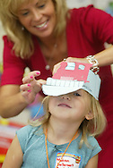 Madison Van Dervoort has her hat adjusted by her teacher Kimberly McDermott during her first day of kindergarten at Minisink Valley Elementary School on Sept. 5, 2007.