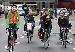 © Licensed to London News Pictures. 10/02/2016. London, UK. A group of cycling medics pass junior doctors on a picket line outside St Thomas' Hospital. Doctors are holding a one day strike over proposed new working hours - only the second strike in 40 years. Photo credit: Peter Macdiarmid/LNP