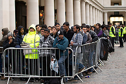 © Licensed to London News Pictures. 21/09/2012. LONDON, UK. Members of the public queue to purchase iPhone 5 handsets outside Apple's Covent Garden store in London today (21/09/12). The iPhone 5, Apples latest mobile phone, went on sale in the UK today, with customers restricted to just two phones per-person and many buying in cash. Photo credit: Matt Cetti-Roberts/LNP