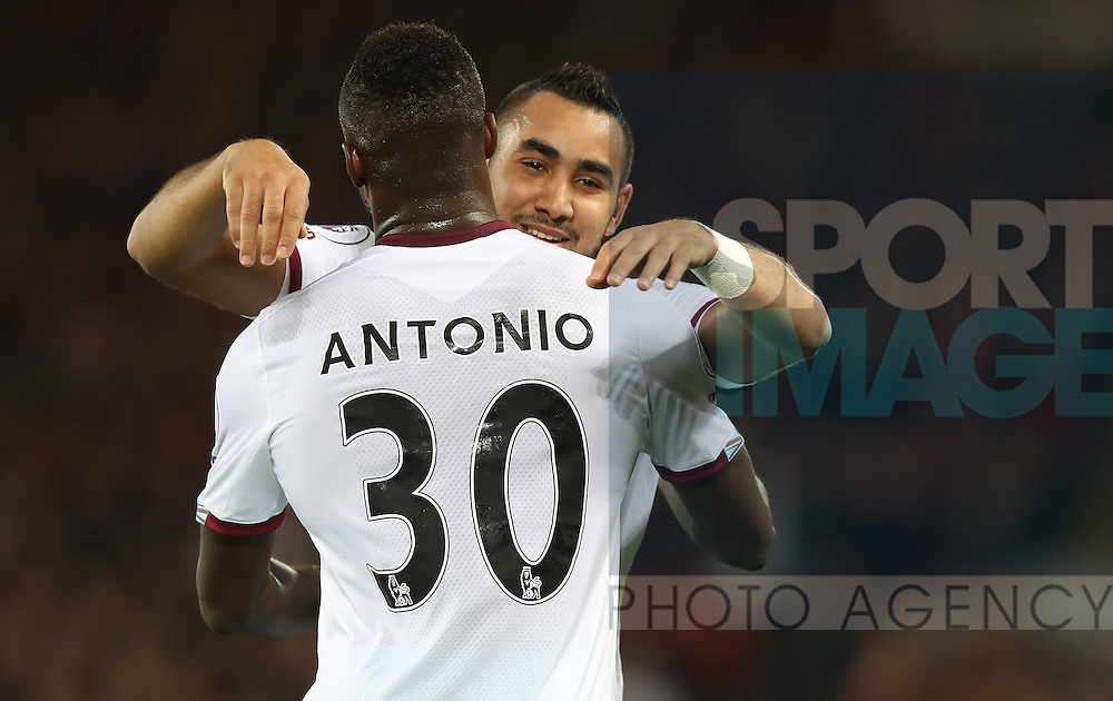 Michail Antonio celebrates with Dimitri Payet of West Ham United during the Premier League match at Anfield Stadium, Liverpool. Picture date: December 11th, 2016.Photo credit should read: Lynne Cameron/Sportimage
