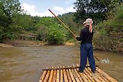 men on a bamboo raft Chiang Mai,  Thailand