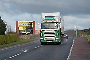 Lorries going across the frontier between Ireland and Northern Ireland border south of Newry. The Republican Irish people do not recognise Ireland as being separated by borders, as they don't use the word London just Derry. There are over a hundred 'peace walls' or security barriers dotted around Northern Ireland. In some areas the barriers are coming down. However with the possibility of Brexit and hard borders the problems existing between communities can escalate, the Good Friday Agreement scuppered and violence threatens to come back