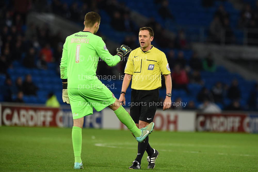 Referee Stuart Attwell has words with Cardiff city goalkeeper David Marshall. Skybet football league championship match, Cardiff city v Watford at the Cardiff city stadium in Cardiff, South Wales on Sunday 28th December 2014<br /> pic by Andrew Orchard, Andrew Orchard sports photography.