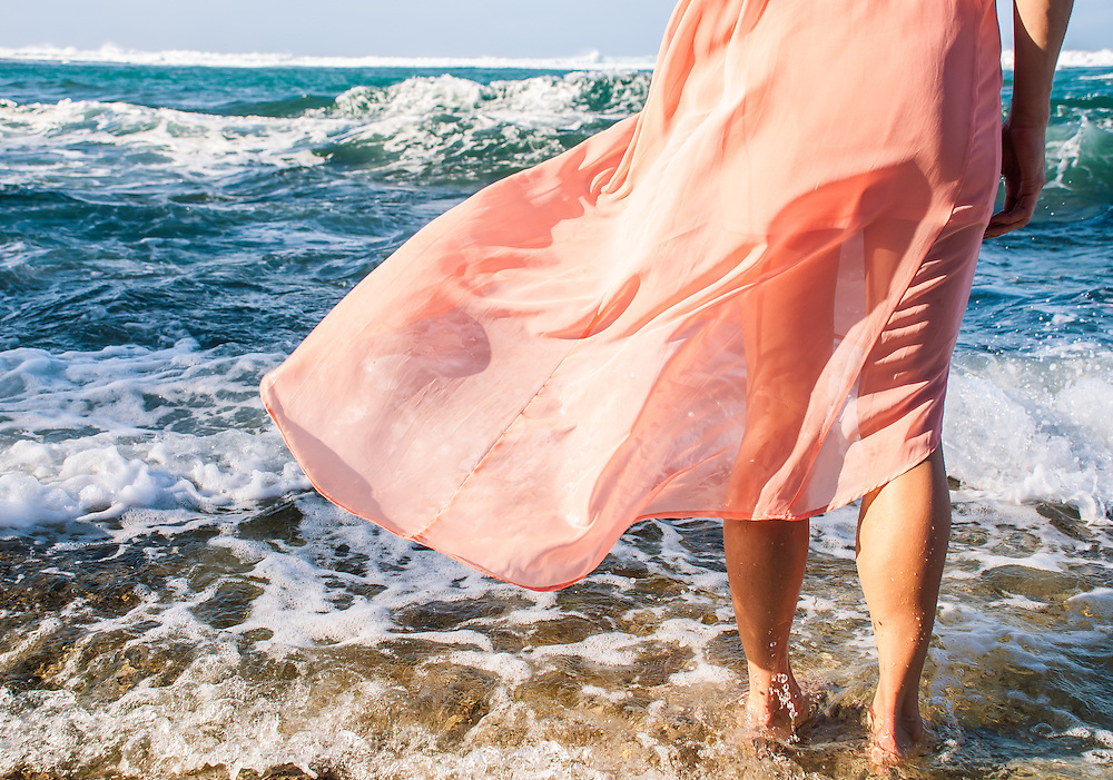 Dress Flowing in the wind over the ocean waves