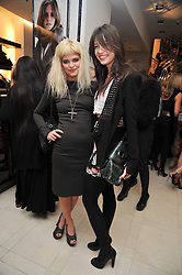 Left to right, PIXIE GELDOF and DAISY LOWE at a reception hosted by Vogue and Burberry to celebrate the launch of Fashions Night Out - held at Burberry, 21-23 Bond Street, London on 10th September 2009.