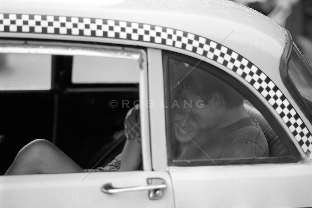 Couple enjoying a ride in a checker cab in New York City