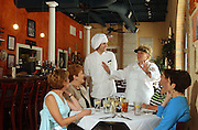 Melillo's at Piazza di Felice: Line Chef Ehren Mayer, center left, and Chef Michele Melillo Clem greet a party of Saturday lunch guests. Guests are, from left, Gail Schank, Mary Rivard, Johanna Campell and Elizabeth Jeffries.