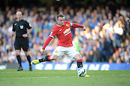 Wayne Rooney, the Manchester United captain taking a shot. Barclays Premier league match, Chelsea v Manchester Utd at Stamford Bridge Stadium in London on Saturday 18th April 2015.<br /> pic by John Patrick Fletcher, Andrew Orchard sports photography.