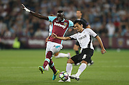 Takayuki Seto of Astra Giurgiu kicks the ball past  Cheikhou Kouyate of West Ham United . UEFA Europa league, 1st play off round match, 2nd leg, West Ham Utd v Astra Giurgiu at the London Stadium, Queen Elizabeth Olympic Park in London on Thursday 25th August 2016.<br /> pic by John Patrick Fletcher, Andrew Orchard sports photography.
