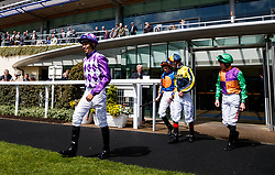 Sean Levey (left) leads the jockey's out before the first race of the day The Sodexo Conditions Stakes at Ascot Races.
