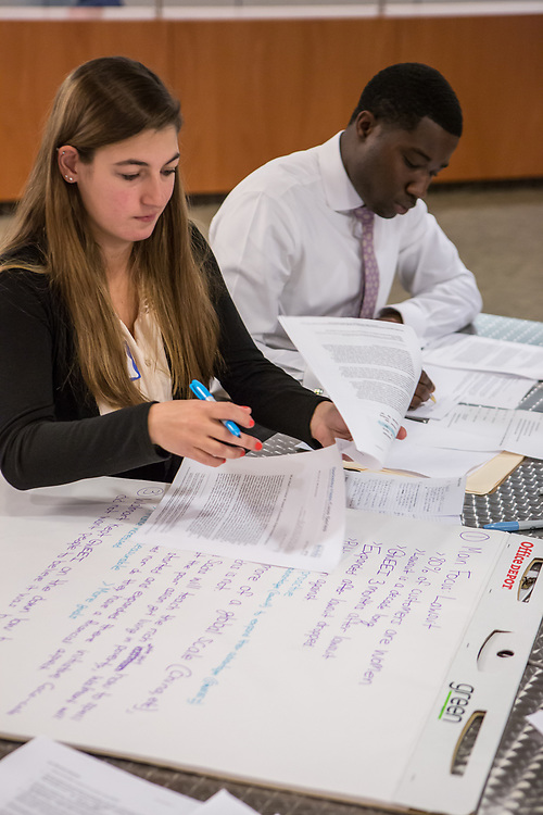 Purchase, NY – 31 October 2014. <br /> Ossining High School's Adriana Sallucci with case notes. With her is Morgan Stanley facilitator Nick Parris. The Business Skills Olympics was founded by the African American Men of Westchester, is sponsored and facilitated by Morgan Stanley, and is open to high school teams in Westchester County.