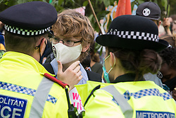 London, UK. 1st September, 2020. Metropolitan Police officers ask a climate activist from Extinction Rebellion to move out of the road around Parliament Square during a Back The Bill rally. Extinction Rebellion activists are attending a series of September Rebellion protests around the UK to call on politicians to back the Climate and Ecological Emergency Bill (CEE Bill) which requires, among other measures, a serious plan to deal with the UK's share of emissions and to halt critical rises in global temperatures and for ordinary people to be involved in future environmental planning by means of a Citizens' Assembly.
