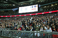 England fans doing a Mexican wave as the scoreboard shows the 2-0 score. England v Spain, Football international friendly at Wembley Stadium in London on Tuesday 15th November 2016.<br /> pic by John Patrick Fletcher, Andrew Orchard sports photography.