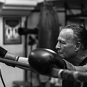 Old local Boxer from La Habra boxing club is watching another bower on the ring.