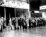 Unemployed men queuing outside a soup kitchen in New York, c1930, during the Great Depression.