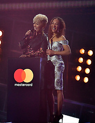 Emeli Sande and sister Lucy on stage at the Brit Awards at the O2 Arena, London.