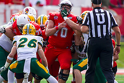 NORMAL, IL - October 05: Drew Bones gets face masked in front of umpire Steve Flanagan during a college football game between the ISU (Illinois State University) Redbirds and the North Dakota State Bison on October 05 2019 at Hancock Stadium in Normal, IL. (Photo by Alan Look)