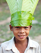A young boy dressed up and dancing for tourists in a temple at Angkor, Siem Reap Province, Cambodia