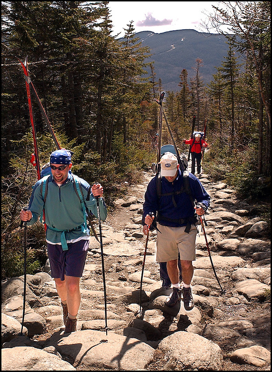 (5/10/03 Mt. Washington, NH) Skier make their way up the rocky trail in order to take advantage of spring conditions at Tuckerman's Ravine. (051003tuckmjs-staff photo  by Michael Seamans. Saved in photo Adv. Sports/cd.)