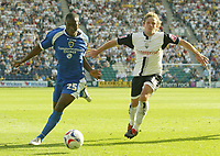 Photo: Aidan Ellis.<br /> Preston North End v Cardiff City. Coca Cola Championship. 09/09/2006.<br /> Cardiff's Malvin Kamara goes past Preston's Paul McKenna
