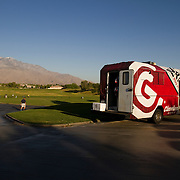 A lone Srixon equipment van, driven by the Golden State Golf Tour's executive directory, and empty parking lots stand in stark contrast to the PGA Tour events.