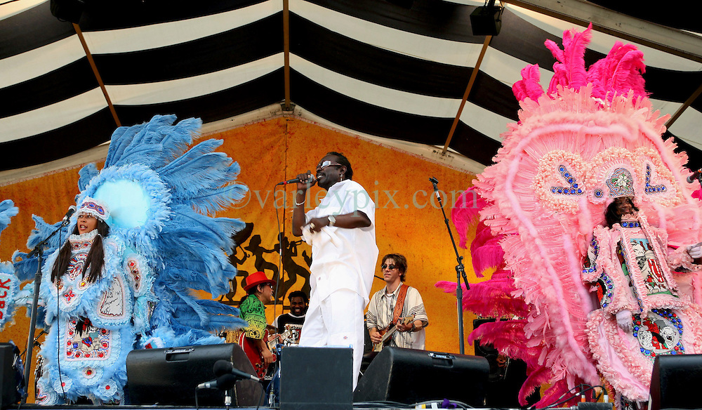 """07 May 2006. New Orleans, Louisiana. The New Orleans Jazz and Heritage festival. Big Chief Bo Dollis of the Wild Magnolias Mardi Gras Indians (mid). Bo Dollis left hospital following illness just a month prior to the festival.<br /> Big Chief Theodore """"Bo"""" Dollis, who led the Wild Magnolia tribe of Mardi Gras Indians in performances around the world passed away January 20th, 2015. He was 71.<br /> Photo; Charlie Varley/varleypix.com"""