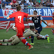 U.S. forward Christen Press (23) scores a goal past Russia goalkeeper Elvira Todua (1) and Russia defender Ekaterina Dmitrenko (7) during an international friendly soccer match between the United States Women's National soccer team and the Russia National soccer team at FAU Stadium on Saturday, February 8, in Boca Raton, Florida. The U.S. won the match by a score of 7-0. (AP Photo/Alex Menendez)