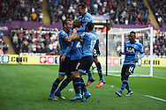 Christian Eriksen of Tottenham (c)celebrates  with his teammates after he scores his teams 2nd goal to equalise at 2-2. . Barclays premier league match, Swansea city v Tottenham Hotspur at the Liberty Stadium in Swansea, South Wales on Sunday 4th October 2015.<br /> pic by  Andrew Orchard, Andrew Orchard sports photography.