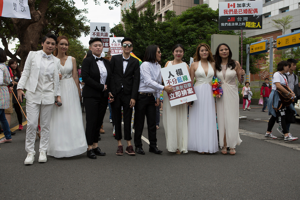 """Campaigning for equal marriage rights at the Pride Parade. The annual march through Taipei's city streets is the largest in Asia, with well over 50 000 people taking part. The 2014 event had the theme """"Walk in Queer's Shoes"""", to encourage the wider community to lend their support for equal marriage rights."""