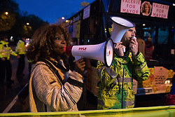 Valerie Brown, Burning Pink London Mayoral candidate, addresses activists from groups including Kill The Bill, United for Black Lives (UBL) and Stop HS2 as Metropolitan Police officers block access to the Westway to all those attending a March On The Motorway event organised by Burning Pink to coincide with the eve of the London Mayoral elections on 5th May 2021 in London, United Kingdom. Burning Pink is a radical political party campaigning for rapid action to combat the climate emergency, among other issues, through the setting up of citizens assemblies.