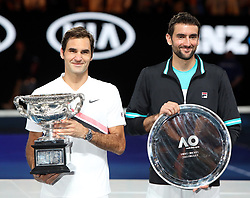 MELBOURNE, Jan. 28, 2018  Switzerland's Roger Federer(L) and Croatia's Marin Cilic hold their trophies during the awarding ceremony of the men's singles final match at Australian Open 2018 in Melbourne, Australia, Jan. 28, 2018. (Credit Image: © Li Peng/Xinhua via ZUMA Wire)