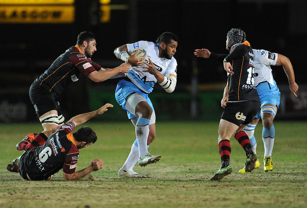 Glasgow Warriors' Taqele Naiyaravoro is tackled by Newport Gwent Dragons' Nick Crosswell<br /> <br /> Photographer Ian Cook/CameraSport<br /> <br /> Rugby Union - Guinness PRO12 Round 16 - Newport Gwent Dragons v Glasgow Warriors - Thursday 25th February 2016 - Rodney Parade - Newport<br /> <br /> © CameraSport - 43 Linden Ave. Countesthorpe. Leicester. England. LE8 5PG - Tel: +44 (0) 116 277 4147 - admin@camerasport.com - www.camerasport.com