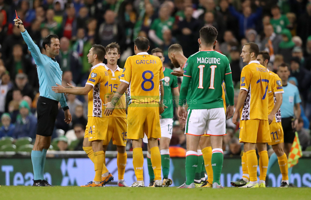 Match referee Bas Nijhuis shows a red card to Moldova's Alexandru Gatcan during the 2018 FIFA World Cup Qualifying, Group D match at the Aviva Stadium, Dublin.