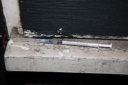 Drug addict's hypodermic needle,