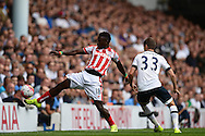 Mame Biram Diouf of Stoke City attempting to control the ball. Barclays Premier league match, Tottenham Hotspur v Stoke city at White Hart Lane in London on Saturday 15th August 2015.<br /> pic by John Patrick Fletcher, Andrew Orchard sports photography.