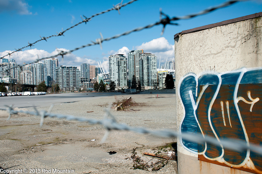Vancouver, BC, Canada - March 9, 2013 - A large empty lot awaits development behind barbed wire.<br />  <br /> Photo: © 2013 Rod Mountain