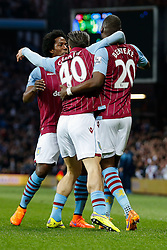 Christian Benteke of Aston Villa celebrates scoring a goal to make it 1-1 with Carlos Sanchez and Jack Grealish (making his first Premier League start) - Photo mandatory by-line: Rogan Thomson/JMP - 07966 386802 - 07/04/2015 - SPORT - FOOTBALL - Birmingham, England - Villa Park - Aston Villa v Queens Park Rangers - Barclays Premier League.
