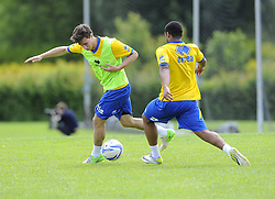Bristol Rovers' Fabian Broghammer battles for the ball with Bristol Rovers' Alefe Santos - Photo mandatory by-line: Joe Meredith/JMP - Tel: Mobile: 07966 386802 24/06/2013 - SPORT - FOOTBALL - Bristol -  Bristol Rovers - Pre Season Training - Npower League Two