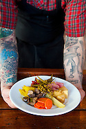 Ned Ludd, a restaurant in NE Portland, where nearly every dish is cooked in the restaurant's wood burning oven. The house made pickle plate.
