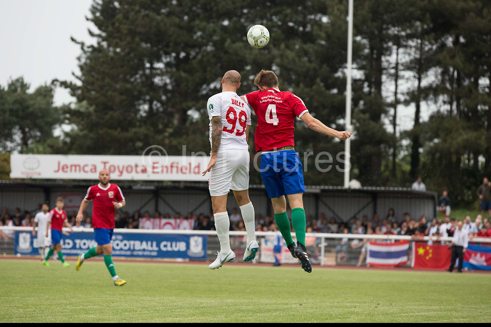 Billy Osman Mehmet heads the ball. Karpatalya (RED) beat Northern Cyprus (WHITE) 3 -2 in penalties during the Conifa Paddy Power World Football Cup finals on the 9th June 2018 at Queen Elizabeth II Stadium in Enfield Town in the United Kingdom. Team mates from the Turkish Republic of Northern Cyprus  take on the Hungarians in Ukraine for the CONIFA World Football Cup final. CONIFA is an international football tournament organised by CONIFA, an umbrella association for states, minorities, stateless peoples and regions unaffiliated with FIFA. (photo by Sam Mellish / In Pictures via Getty Images)