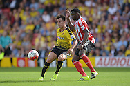 Jose Manuel Jurado of Watford is challenged by Victor Wanyama of Southampton. Barclays Premier League, Watford v Southampton at Vicarage Road in London on Sunday 23rd August 2015.<br /> pic by John Patrick Fletcher, Andrew Orchard sports photography.