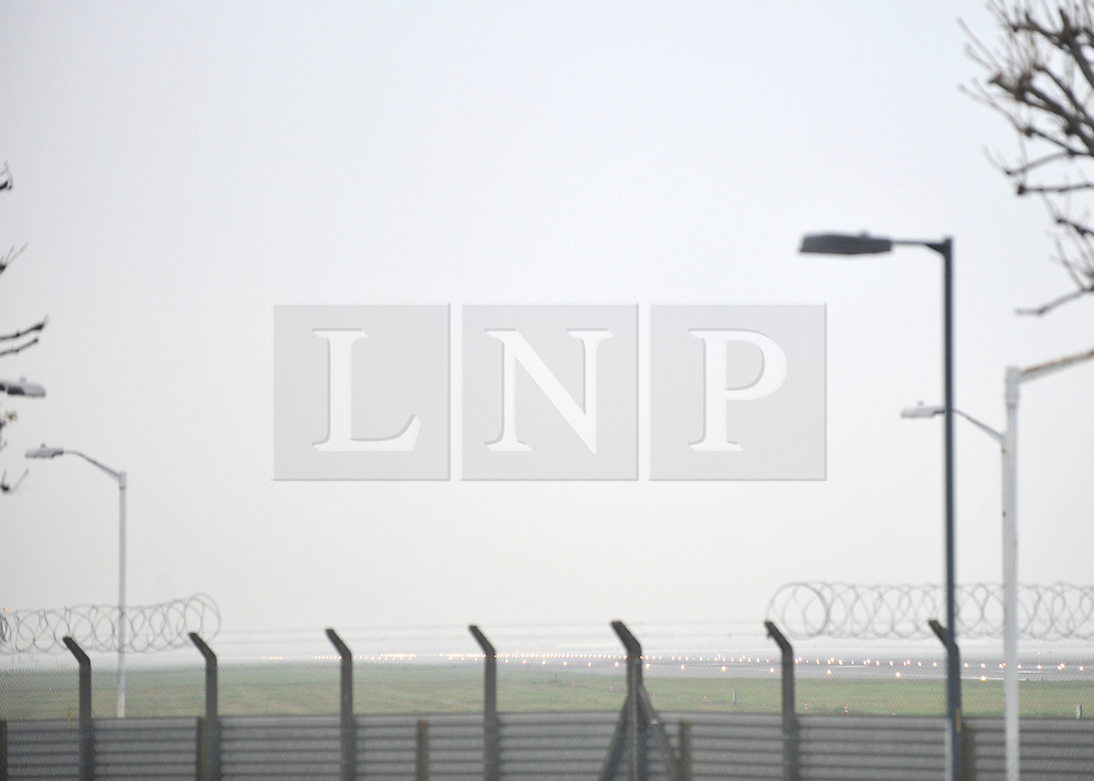 © Licensed to London News Pictures. 21/11/2011, Heathrow, UK. An empty runway shrouded in fog.  Flight delays continue at London's Heathrow Airport today. By 6.30am today a total of 21 flights from Heathrow were already cancelled affecting destinations including Manchester, Glasgow, Amsterdam, Brussels, Stockholm, Cologne and Nice.. Photo credit : Stephen Simpson/LNP