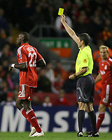 Photo: Paul Thomas.<br /> Liverpool v Bordeaux. UEFA Champions League, Group C. 31/10/2006.<br /> <br /> Momo Sissoko (L) of Liverpool is given a yellow card by Referee Markus Merk.