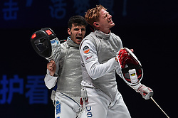 WUXI, July 27, 2018  Andrea Cassara (L) of Italy and Alexander Massialas of the US react during the men's foil team final between Italy and the United States at the Fencing World Championships in Wuxi, east China's Jiangsu Province, July 27, 2018. Italy beat US 45-34 and claimed the title of the event. (Credit Image: © Li Bo/Xinhua via ZUMA Wire)