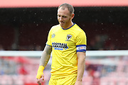 AFC Wimbledon defender Barry Fuller (2) smiling whilst looking to the ground during the Pre-Season Friendly match between Ebbsfleet and AFC Wimbledon at Stonebridge Road, Ebsfleet, United Kingdom on 29 July 2017. Photo by Matthew Redman.