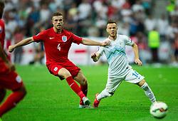 Jordan Henderson of England vs Dejan Lazarevic of Slovenia during the EURO 2016 Qualifier Group E match between Slovenia and England at SRC Stozice on June 14, 2015 in Ljubljana, Slovenia. Photo by Vid Ponikvar / Sportida