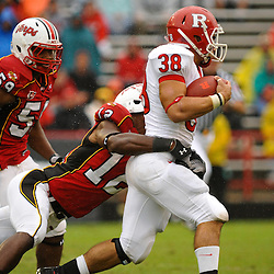 Sep 26, 2009; College Park, MD, USA; Rutgers running back Joe Martinek (38) runs through the tackle of Maryland defensive back Kenny Tate (12) during the first half of Rutgers' 34-13 victory over Maryland in NCAA college football at Byrd Stadium.
