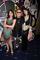 Left to right, KARMA NABULSI, SIR ELTON JOHN and BELLA FREUD at The Hoping Foundation's 'Starry Starry Night' Benefit Evening For Palestinian Refugee Children held at The Cafe de Paris, Coventry Street, London on 19th June 2014.