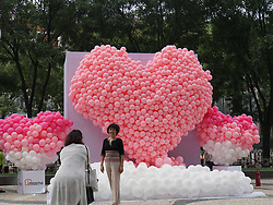 August 28, 2017 - Beijin, Beijin, China - Beijing, CHINA-28th August 2017: (EDITORIAL USE ONLY. CHINA OUT) ..The pink heart shaped balloons can be seen on Wangfujing in Beijing, August 28th, 2017, marking the Chinese Valentine's Day. (Credit Image: © SIPA Asia via ZUMA Wire)